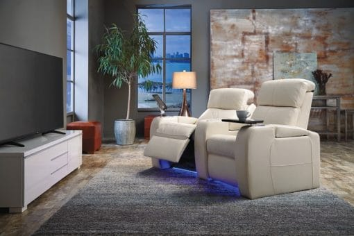 Image depicts a modern living room with 2 white home-theatre seats.