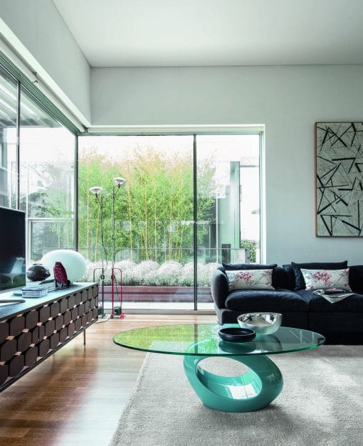 Image depicts a living room with modern furniture, including sofas, coffee table and more.