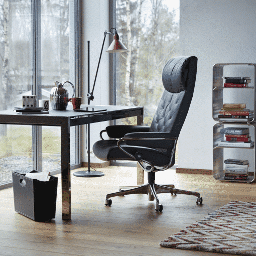 Image show a modern blue office chair in a home office.